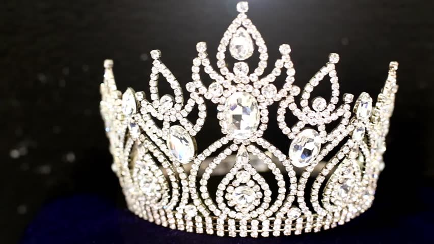 Diamond Crown of Beauty Pageant Contest, dolly slider from right to left with black background and flare lighting movement