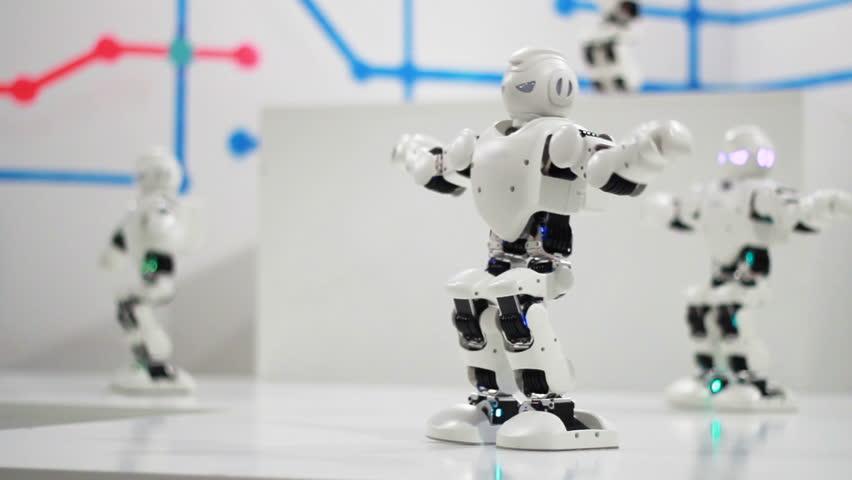 Humanoid robot dance. Group of cute robots dancing. Close up of smart robot dance show. Dancing robot performance. Robotic dance party. Smart robotic technology