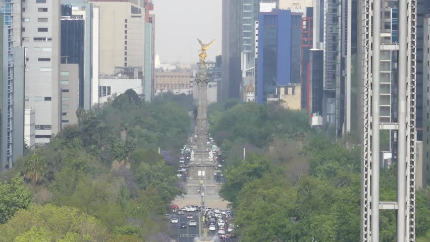 The historical The Angel of Independence (El Angel de la Independencia), Paseo de la Reforma and the surrounding buildings of Mexico City, Mexico