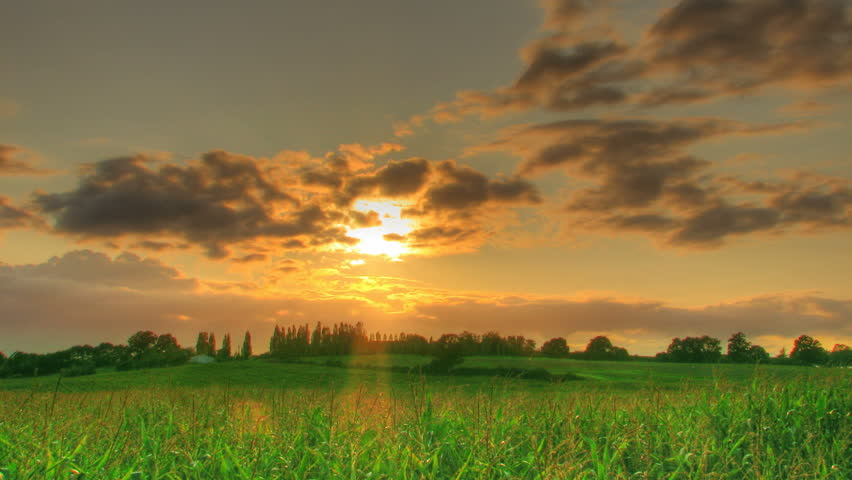 HDR time lapse of sunset over corn fields, high dynamic range imaging.