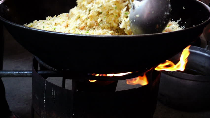 Fried Rice Cooking On Big Pan Hd Slow Motion Hd Stock Footage Clip