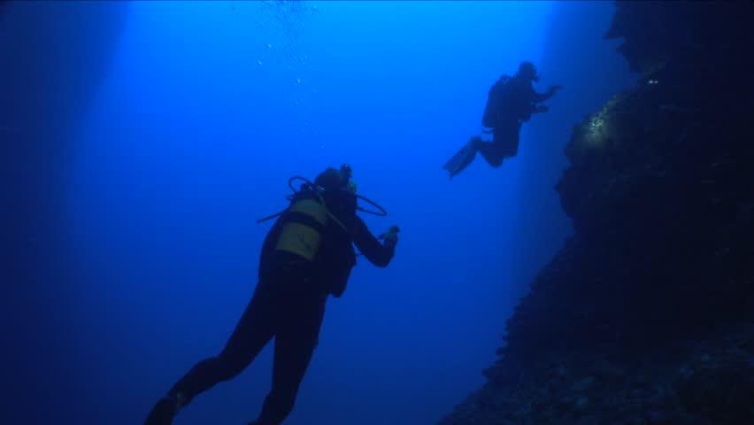 Scuba divers exploring a cave underwater cave dive | Shutterstock HD Video #24305348