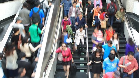 SHANGHAI, CHINA - CIRCA MAY 2012: Time lapse of People hurrying in the Subway station circa MAY 2012 in Shanghai, China.