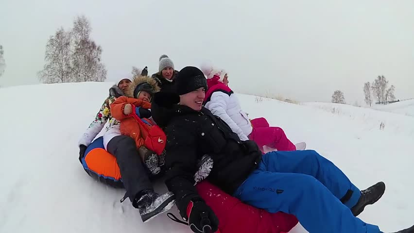 Happy family rides and smiling snowtube on snowy roads. slow motion. snow winter landscape. outdoors sports | Shutterstock HD Video #24317720