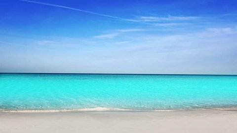 Balearic Ibiza Formentera turquoise beach with white sand and blue summer sky