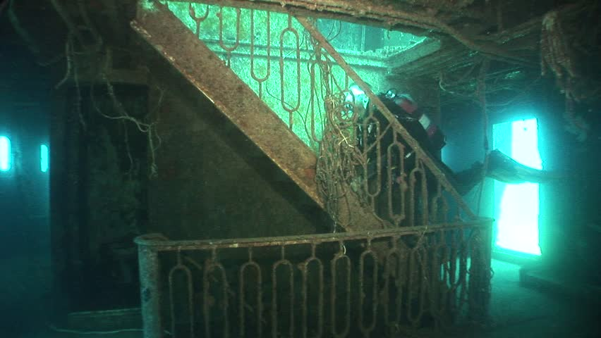 scuba diver exploring ship wreck underwater shipwreck