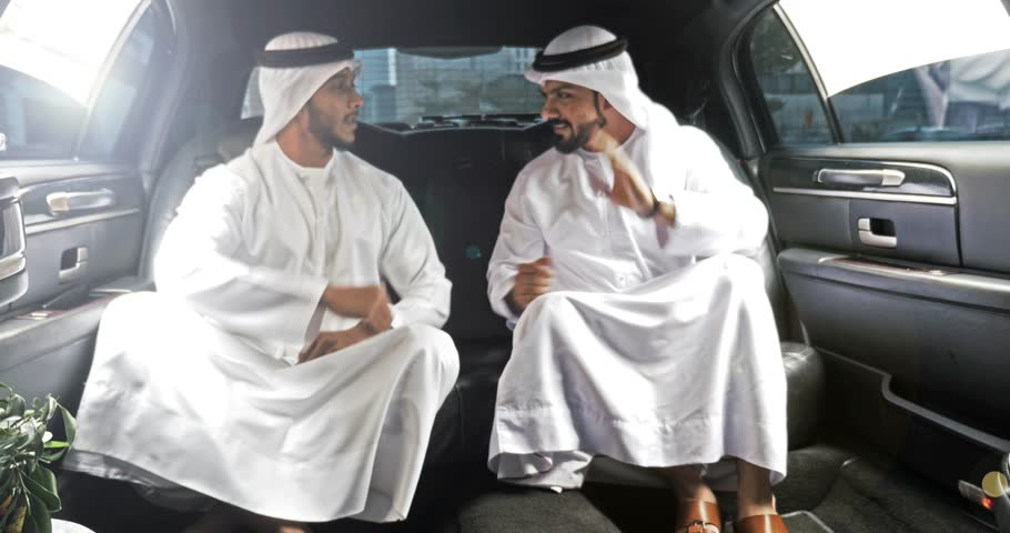 Two arabian business men on the company limousine.