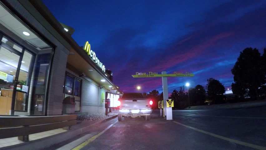 Denver, Colorado, USA-February 11, 2017. POV point of view - McDonald's drive-through in early morning.