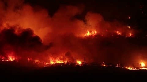 FOUNTAIN GREEN, UTAH - JUN 23: The Sanpete forest fire burns out of control during the night in Wood Hollow Canyon on June 23, 2012 in Fountain Green, Utah. The fire had burned over 6,000 acres and caused more than 500 homes to be evacuated as of June 25.