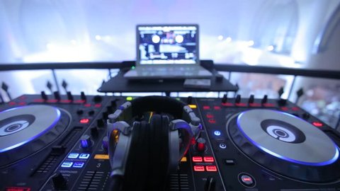 Dj Mixer and Headphone in Night Club Disco Party