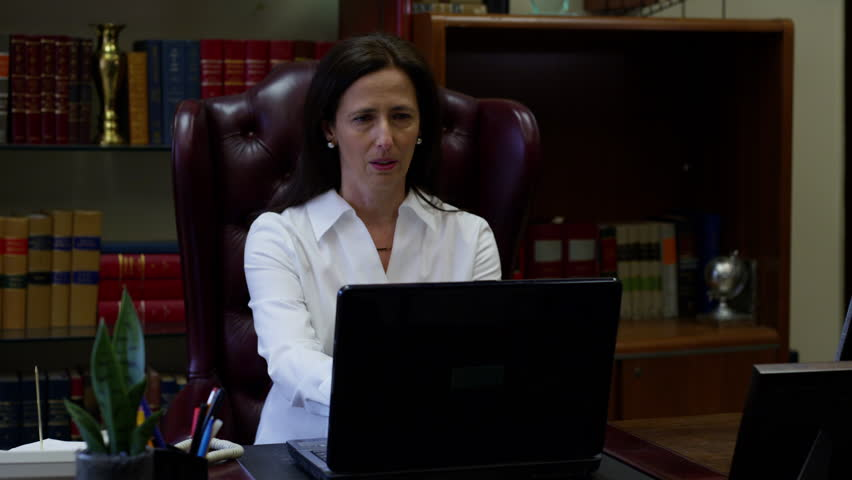 Professional woman rushing out of office after phone call | Shutterstock HD Video #24377120