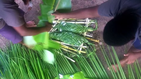 Time lapse of Fijian men preparing Fijian food Lovo. Lovo (Fijian cooking food underground) is commonly made during special events such as funerals, weddings, Christmas or birthdays.