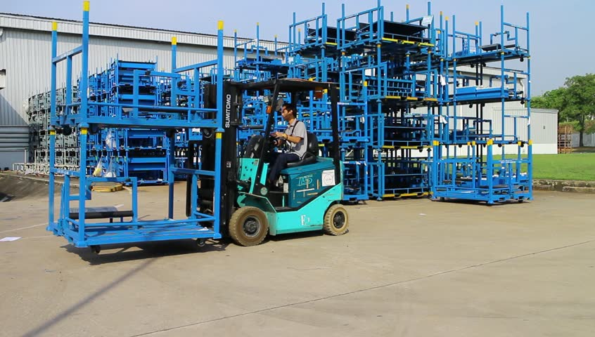 Rayong Thailand , February 27 - 2017 : Lift truck working in factory for lift up steel structure and material  | Shutterstock HD Video #24386300