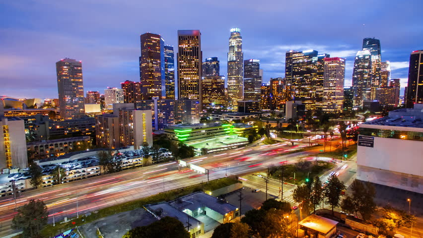 4K Spectacular Aerolapse ( timelapse / hyperlapse ) view of the big city skyscrapers and rush hour traffic on 110 freeway in Downtown, Los Angeles