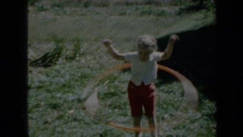 MINNESOTA 1958: child hula-hooping.