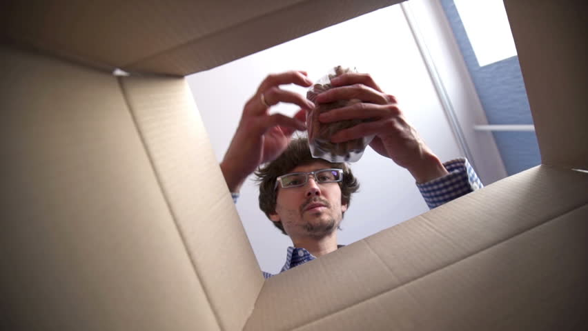 Man opening a Food delivery box at home