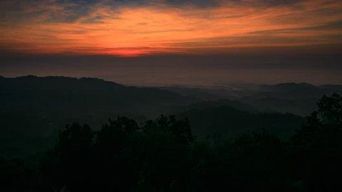 Doi tung national park covered by morning fog and sunrise at Doi pha mee, Maesai, Chiang rai, Thailand