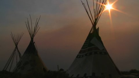 Teepees at sunset