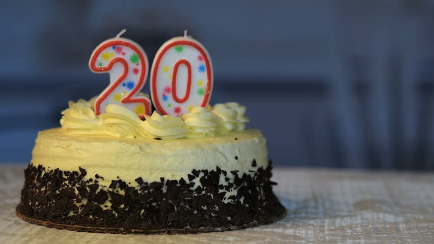 Birthday Cake With 20 Candles On It Hand Re Aching In And Lighting The