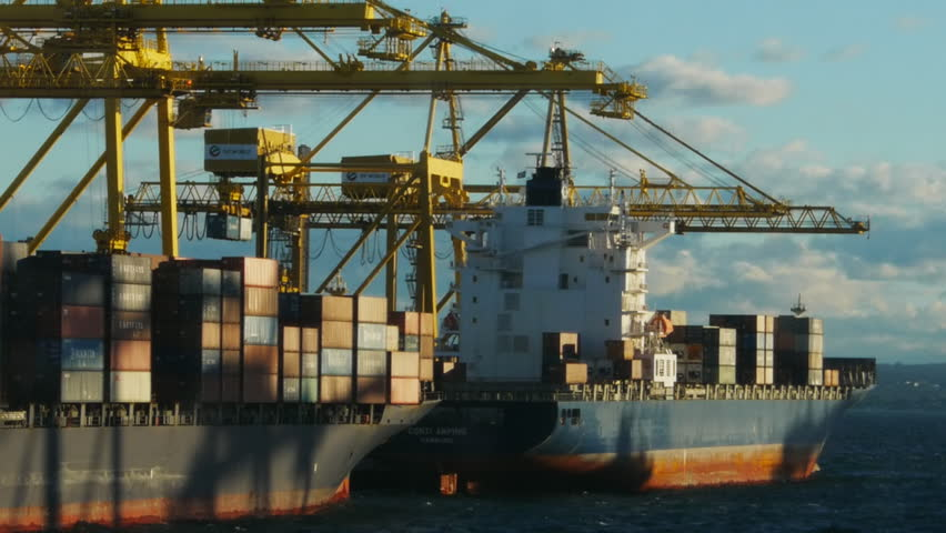 SYDNEY - CIRCA JUNE 2012: Two container ships are loaded by crane at Port Botany circa June 2012 in Sydney, Australia.