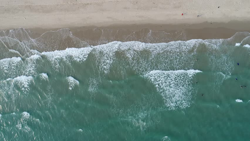 Aerial drone footage of ocean waves reaching shore. Beach on aerial drone top view.  | Shutterstock HD Video #24585830