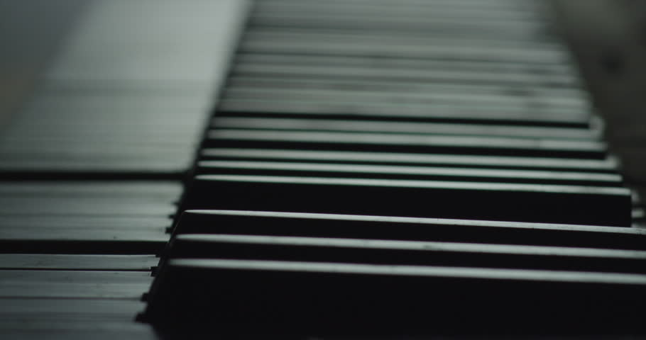 Piano Keyboard keys playing without player. Black and White, slow motion | Shutterstock HD Video #24614129