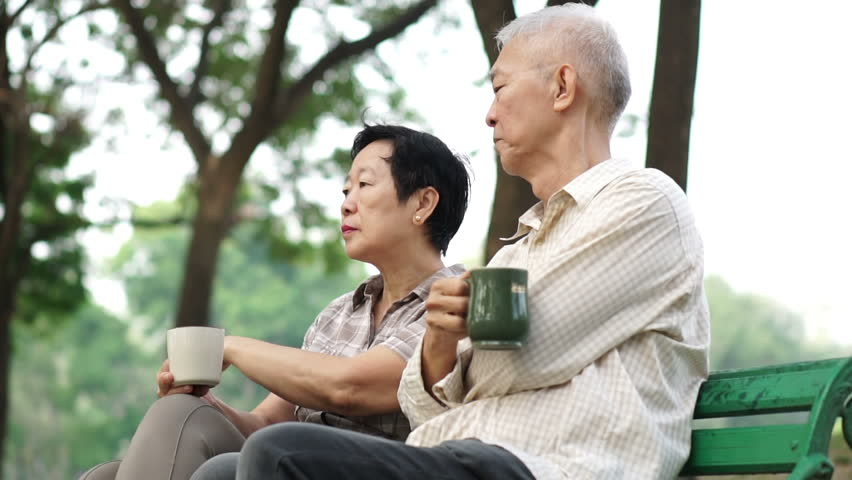 Slow motion tired and worry senior couple sitting, drinking coffee. Life after retirement, financial and future planning