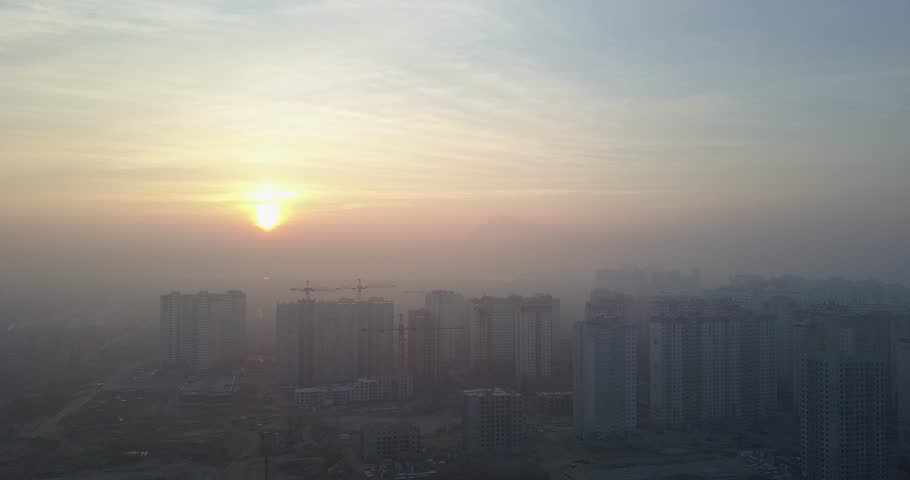 Sunset over a big city with tall houses. Aerial view | Shutterstock HD Video #24664790