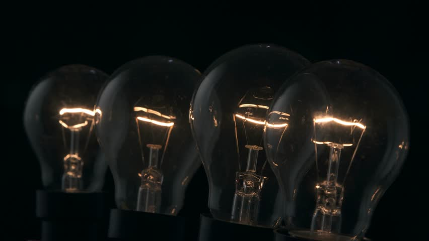 Group of light bulbs turning on.  | Shutterstock HD Video #24683240