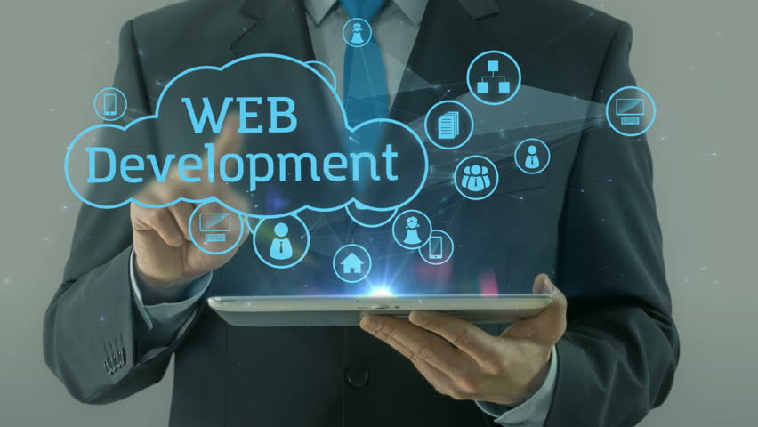Business man pointing on web development concept tablet pad | Shutterstock HD Video #24707120