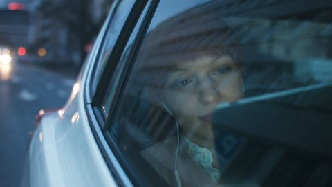 Businesswoman in the Car Looking Through a Window