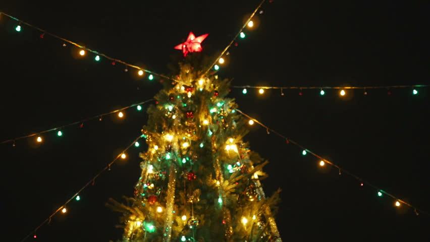 Animated Shiny Lights On Green Christmas Tree With Designer Snow ...