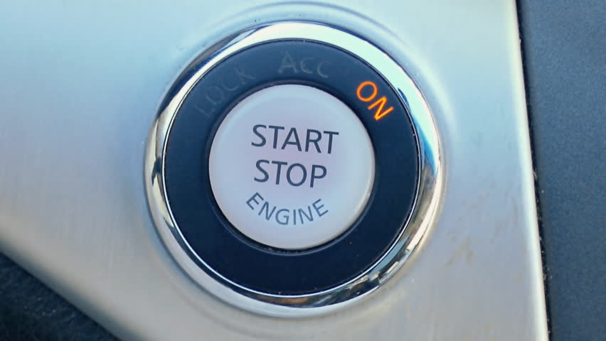 Person using push button car engine ignition start closeup