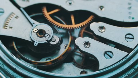Watch mechanism macro loop.Old vintage clock mechanism working, closeup shot with soft focus.Close up of a internal clock mechanism.Vintage Watch Gears Movement Macro