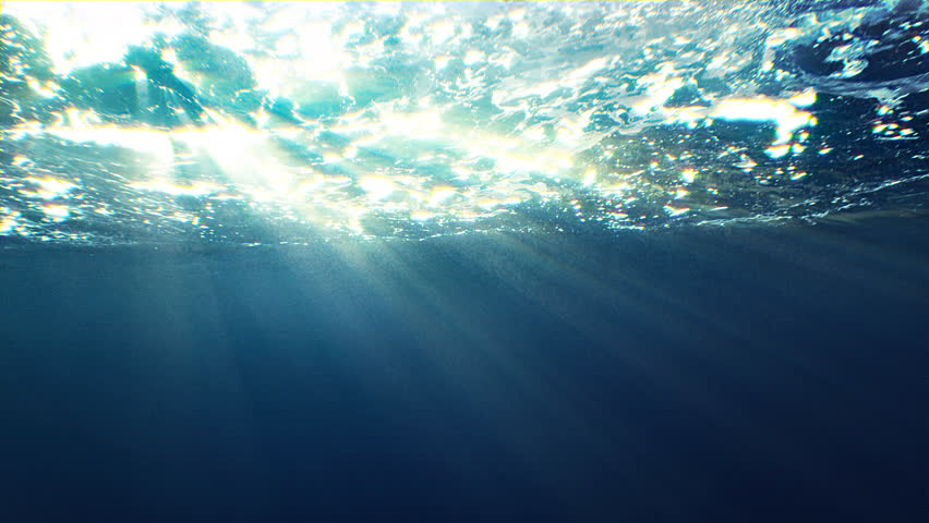 Beautiful underwater sea scene view with natural light rays, shining through the water's glittering and moving surface, caustics, bubbles, and foam, perfect for background and digital composition | Shutterstock HD Video #24773720