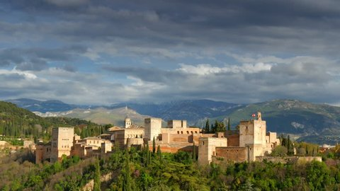 Cityscape of Granada.  Alhambra palace and fortress complex.  Andalusia, Spain. Time lapse