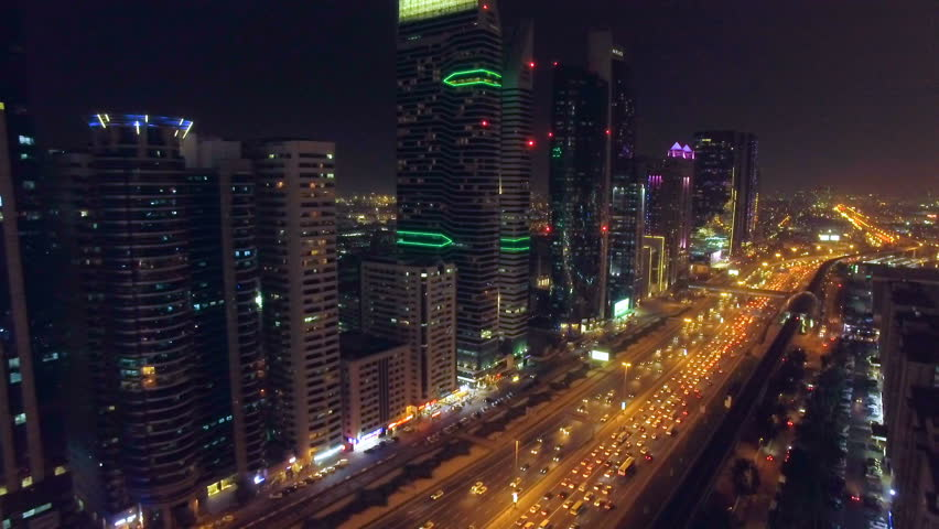 Flight in the night city with roads, cars, and skyscrapers. Dubai, UAE #24789170