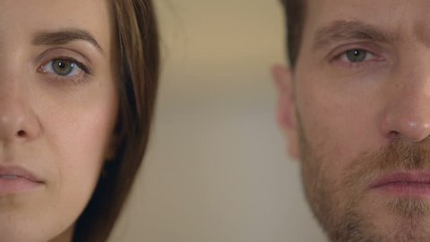 Male and female half face looking into camera, gender equality, opinion poll