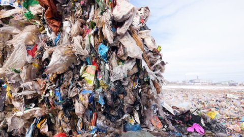 Big piles of garbage. Empty bottles, plastic in the waste dump. Dolly shot.
