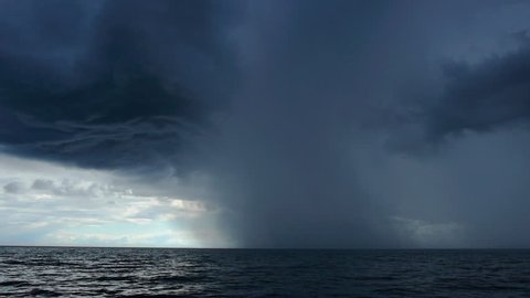 Storm Clouds at sea 24/07/2012, Norwegian Sea. Long shot tilting down of storm cloud formation at sea.