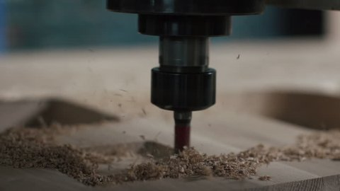 Automatic milling cutting wood machine.  drill holes for the pieces of wood. Closeup. Slowmotion