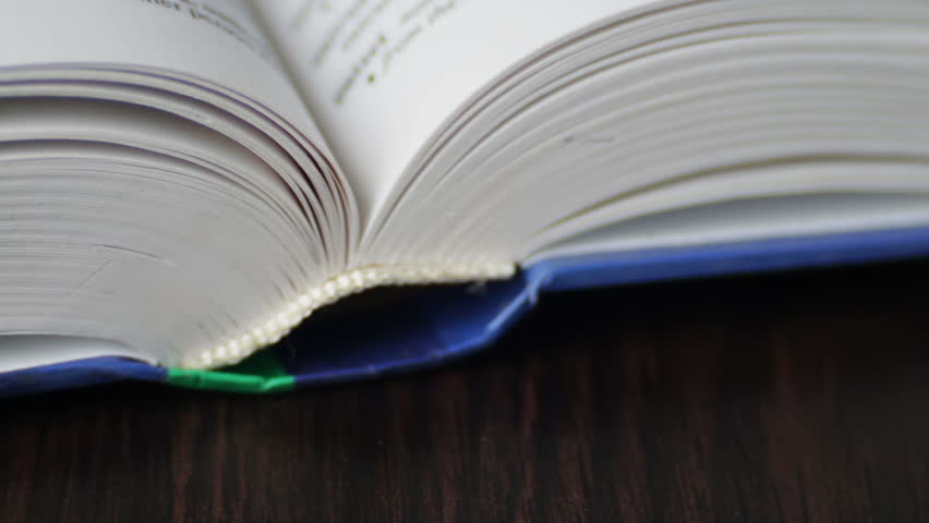 New Book pages turning, leafing and book,Closeup leafing of pages new paper book | Shutterstock HD Video #24920900