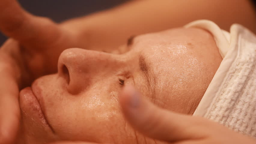 Woman getting a cosmetic peel off mask facial massage at spa salon skincare.    Shutterstock HD Video #24937190