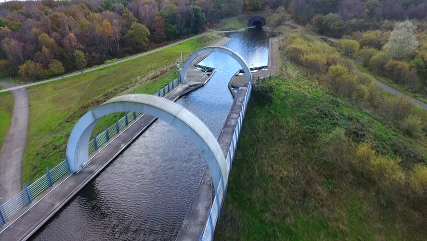 Falkirk Wheel. Unique boat lift joining the Forth and Clyde canal and the Union Canal in Central Scotland. | Shutterstock HD Video #24956372