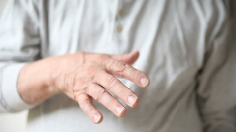 man with a tremor in his hand