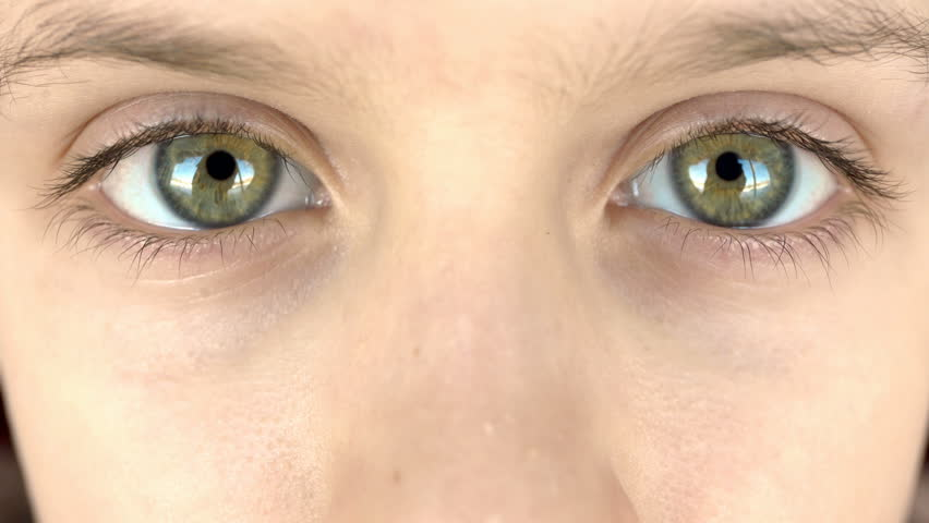 Close-up of young boy's eyes looking at the camera