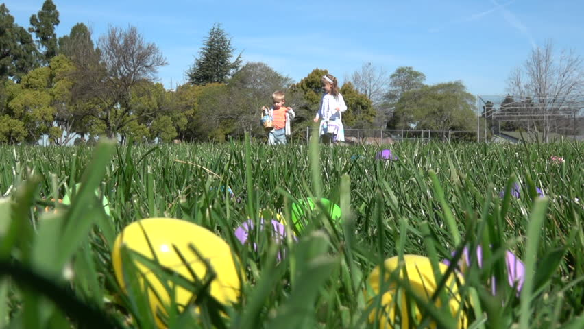 Slow motion of kids having fun gathering eggs at Easter hunt #24973190