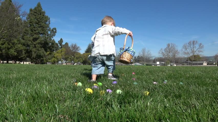 Slow motion of kids having fun gathering eggs at Easter hunt #24973220