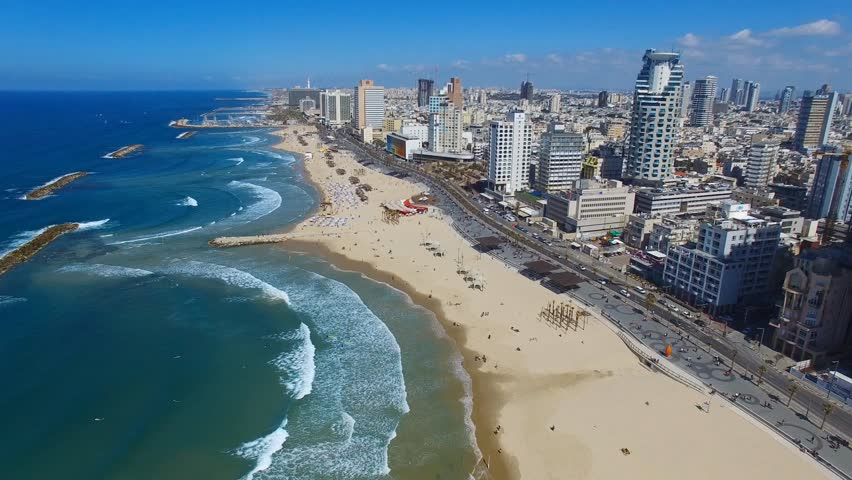Tel Aviv, Israel - March 4, 2017: Aerial footage of Tel Aviv's coastline with sea front hotels, buildings and people at the beach.