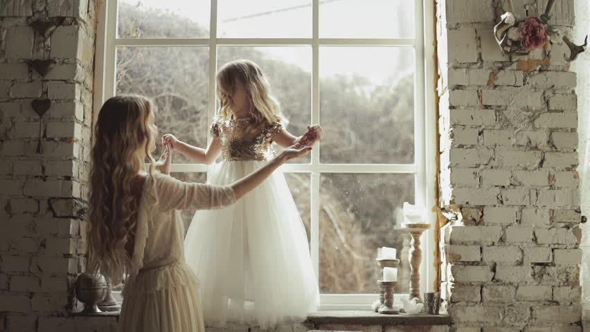 Mother and daughter hugging and playing together. Pretty little girl on beautiful woman's hands. Girls in lace dresses playing in decorated room. Family weekend, beauty day, having fun, love concept. | Shutterstock HD Video #25027124